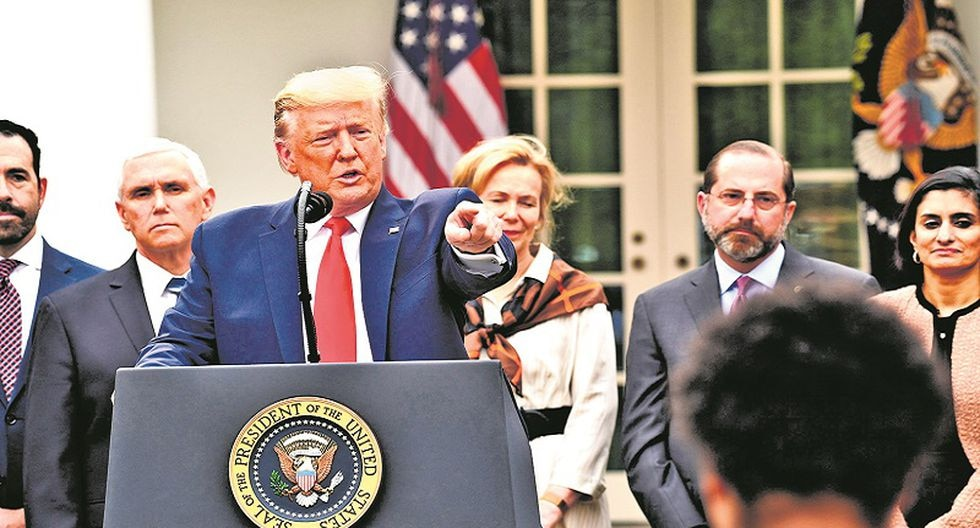 US President Donald Trump takes questions from reporters at a news conference about COVID-19, known as the coronavirus, in the Rose Garden of the White House in Washington, DC, March 13, 2020. US President Donald Trump declared the novel coronavirus, COVID-19, a national emergency on March 13, 2020.  / AFP / SAUL LOEB