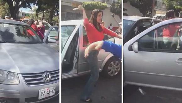 Familia se demora en cruzar la calle y conductora los agarra a golpes (VIDEO)