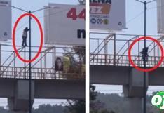 Hombre baila sobre puente peatonal y se desliza por poste de luz   VIDEO