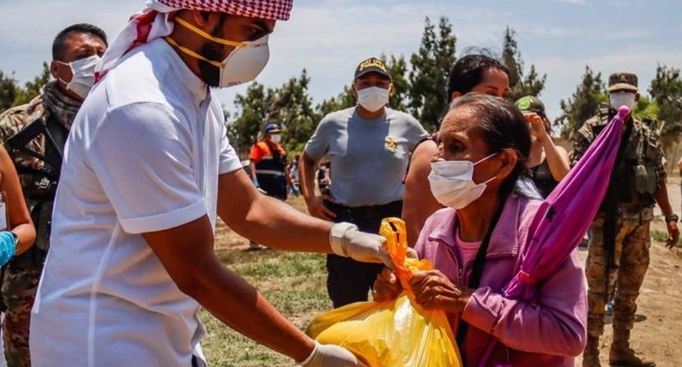 El ejército y la Policía apoyaron al empresario árabe para que entregue la ayuda en Cartavio, La Libertad. (Foto: GEC)