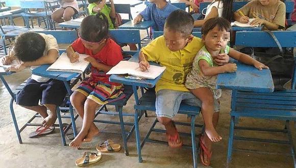 Niño lleva al colegio a su hermana bebé para no perder sus clases (FOTO)