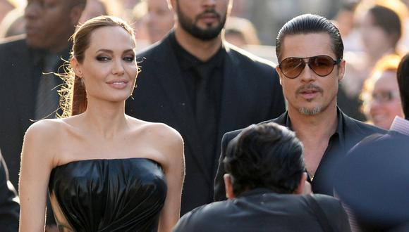 """Angelina Jolie and Brad Pitt arrive for the world premiere of Disney's """"Maleficent,"""" May 28, 2014, at El Capitan Theatre in Hollywood, California. AFP PHOTO / ROBYN BECK (Photo by ROBYN BECK / AFP)"""